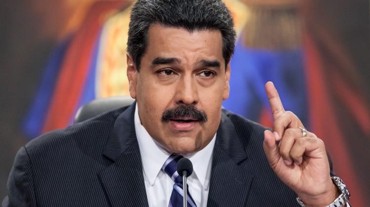 """CAR01. CARACAS (VENEZUELA), 30/12/2014.- El presidente venezolano, Nicolás Maduro, habla durante una rueda de prensa sobre el """"programa económico de recuperación"""" para el 2015 del país hoy, martes 30 de diciembre de 2014, en el Palacio de Miraflores de Caracas (Venezuela). EFE/Miguel Gutiérrez"""