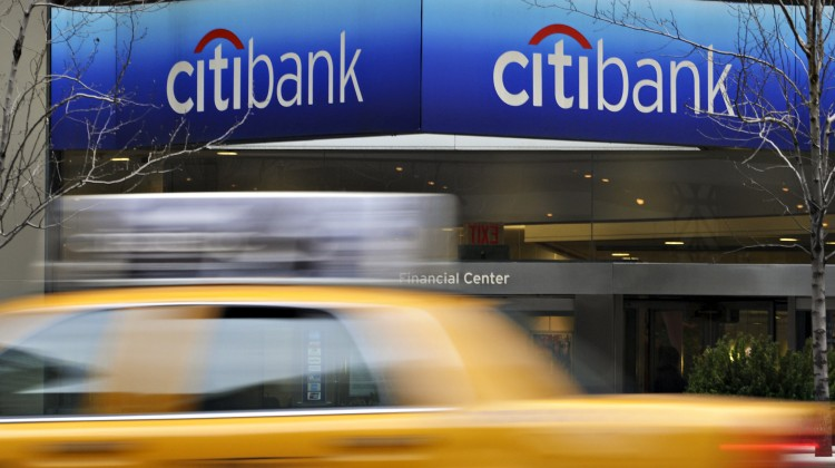 A taxi passes a Citibank branch located in the headquarters of Citigroup in New York, U.S., on Tuesday, Jan. 19, 2010. Citigroup, the U.S. bank that is 27 percent owned by the Treasury Department, ended a three-quarter profit streak with a $7.6 billion loss on costs to exit the government's bailout program. Photographer: Jonathan Fickies/Bloomberg