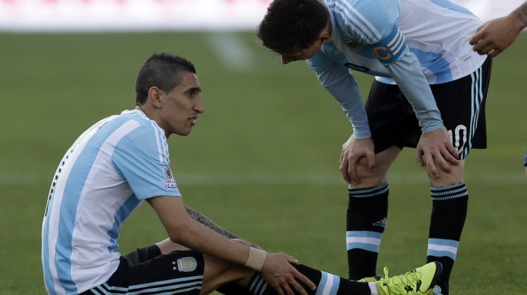 Argentina's Lionel Messi , right, talks to teammate Angel Di Maria  as he lies on the ground during the Copa America final soccer match at the National Stadium in Santiago, Chile, Saturday, July 4, 2015. (AP Photo/Natacha Pisarenko)