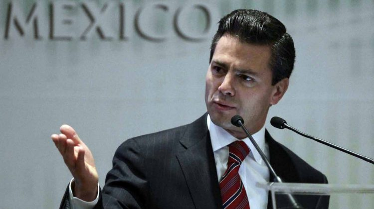 Former Mexico state governor Enrique Pena Nieto, a potential presidential candidate for the opposition Institutional Revolutionary Party (PRI), speaks during a Confederation of National Chambers of Commerce, Mexico (Concanaco) event in Mexico City November 25, 2011. Pena Nieto, the frontrunner in Mexico's 2012 presidential race, on November 27, 2011 registered in Mexico City as the official presidential candidate of the PRI. Picture taken November 25, 2011. REUTERS/Henry Romero (MEXICO - Tags: POLITICS ELECTIONS) ORG XMIT: HNR05