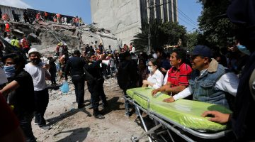 Paramedics wait as rescue personnel search for people in the rubble of a collapsed building after an earthquake hit Mexico City, Mexico September 19, 2017. REUTERS/Claudia Daut